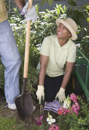 Middle-aged couple gardening