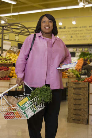 Woman shopping in grocery store Stock Photo - 16074260