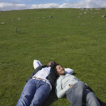 Couple laying in grass together Stock Photo - 16074261