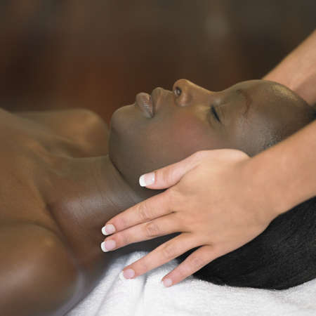 two persons only: Young woman having a scalp massage