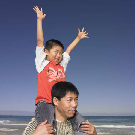 Father carrying his son on his shoulders Stock Photo - 16074284