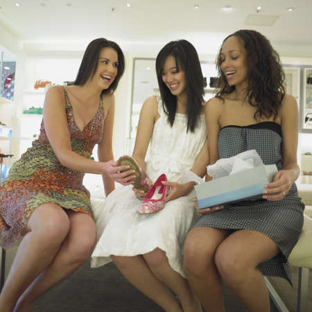Young women shopping for shoes together Stock Photo - 16074288