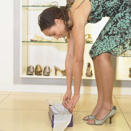 Young woman trying on shoes Stock Photo - 16074289