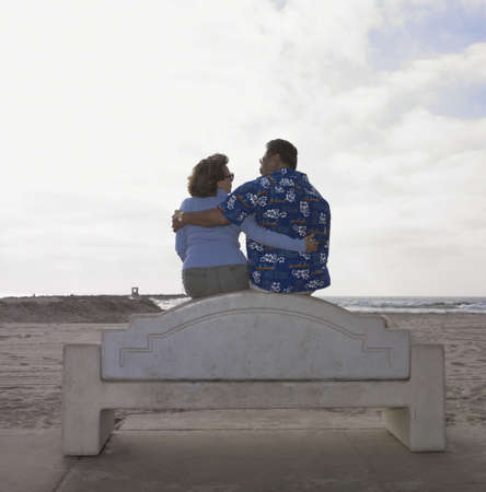 Tourist couple hugging on the beach Stock Photo - 16074310