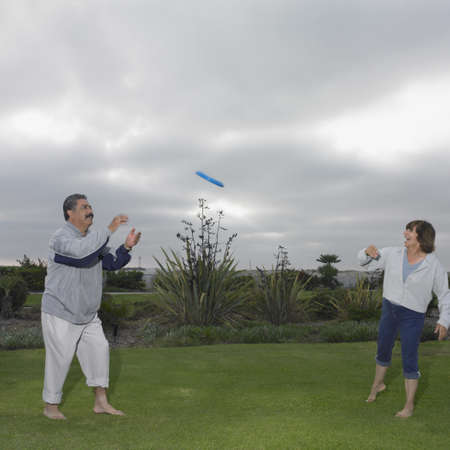 frisbee: Mature couple playing Frisbee