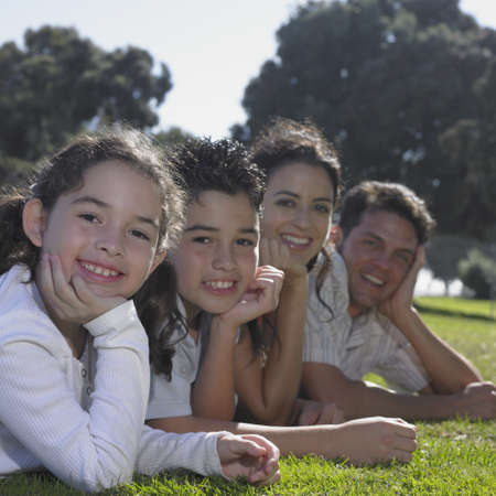 Family posing for the camera on green lawn Stock Photo - 16074322