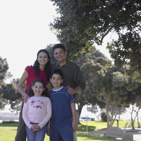 Family posing for the camera in park Stock Photo - 16074324