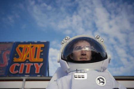 spacesuit: Man in spacesuit leaving ÏSpace CityÓ