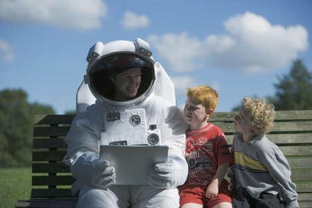 spaceman: Astronaut talking to children