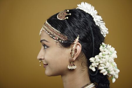 woman profile: Indian woman wearing traditional facial jewelry