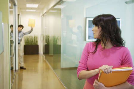 motioning: Businesswoman holding folders