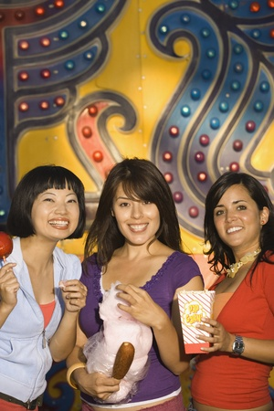 Young women holding food at a carnival Stock Photo - 16074427
