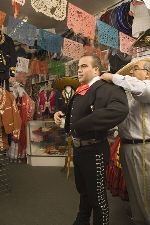 Young man trying on a matador outfit