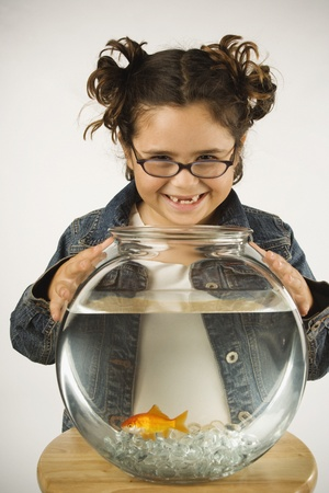 Young girl holding a fishbowl Stock Photo - 16074464