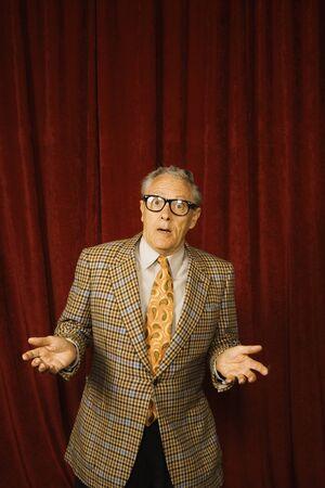 geeky: Older man shrugging in geeky glasses