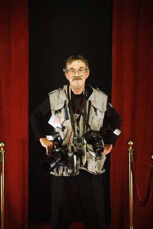 notoriety: Photographer standing on the red carpet