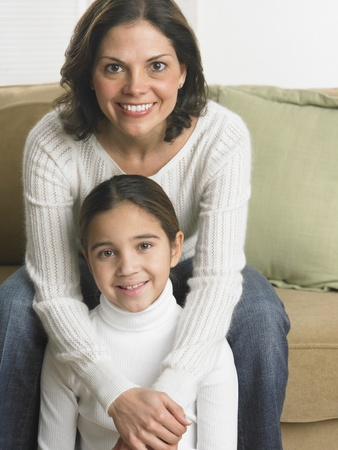 Mother and daughter smiling for the camera Stock Photo - 16074504