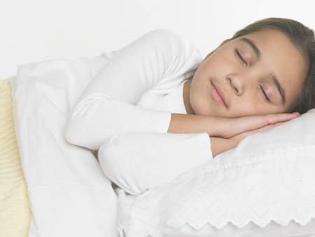 bedcover: Young girl asleep in bed