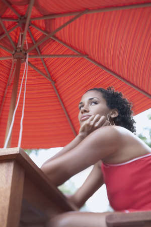 spectating: Low angle portrait of young woman