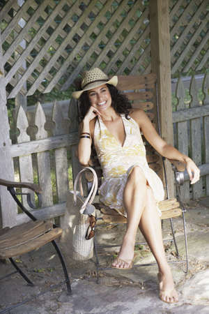 barefoot cowboy: Young woman relaxing in a lawn chair