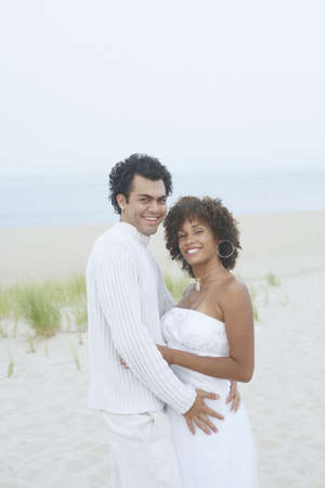 Young couple hugging on the beach Stock Photo - 16074653