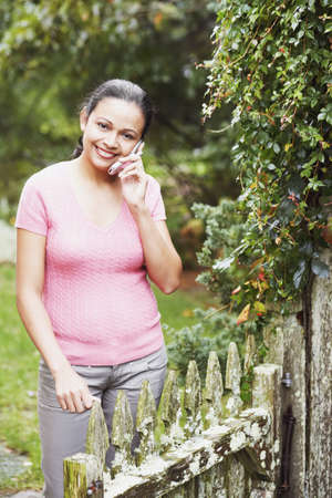 Young woman talking on her cell phone outdoors Stock Photo - 16074664