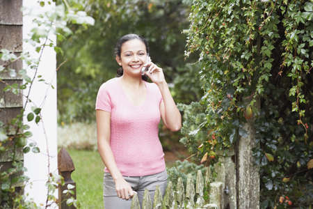Young woman talking on her cell phone outdoors Stock Photo - 16074665