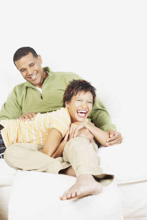 Couple relaxing together on the couch Stock Photo - 16074683