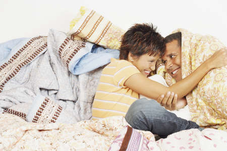 bedcover: Young couple relaxing among blankets