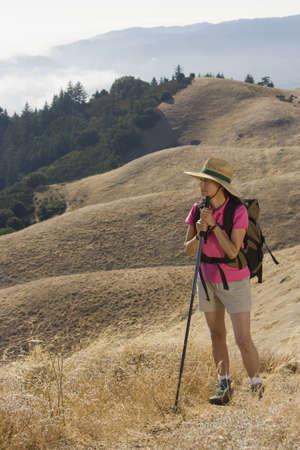 stepping: Senior woman hiking LANG_EVOIMAGES