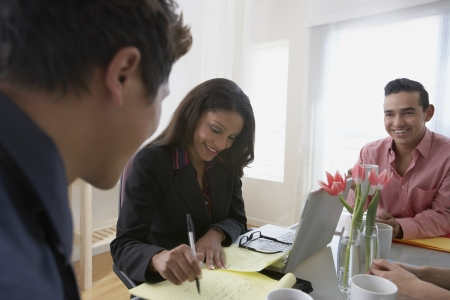 african american woman business: Businesspeople having a meeting
