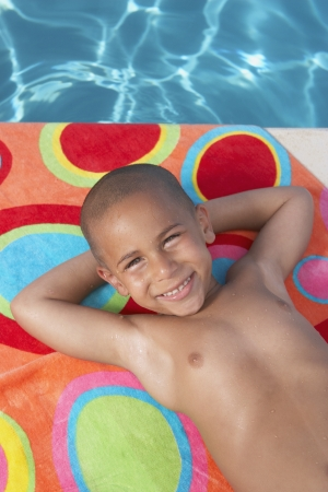 Young boy relaxing on a towel Stock Photo - 16089205