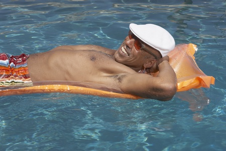 Middle-aged man relaxing on an inflatable raft Stock Photo - 16089209