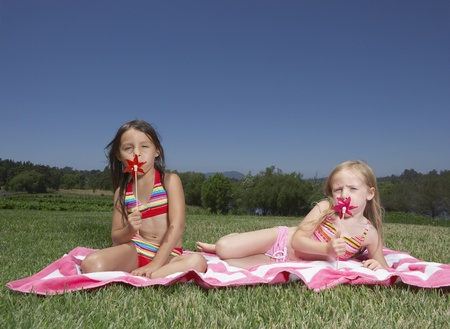 two persons only: Young girls playing with pinwheels