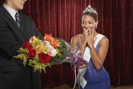 gasping: Beauty queen gasping and receiving flowers