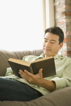 davenport: Young man reading on the couch