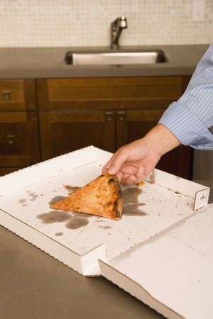 appendage: Man having a piece of pizza