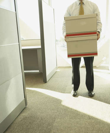 two persons only: Businessman carrying boxes LANG_EVOIMAGES