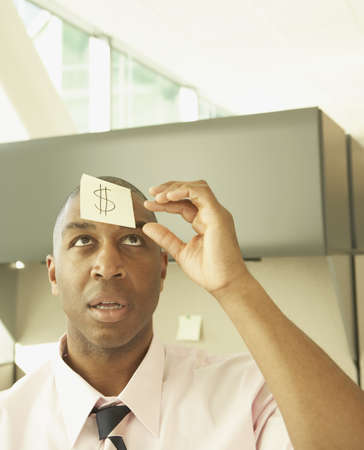 dollarbill: Businessman wearing a question mark on his forehead LANG_EVOIMAGES