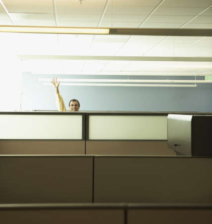 longshot: Businessman waving from behind partition