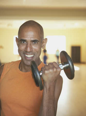 Man lifting weights Stock Photo - 16089312