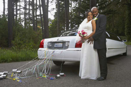 honeymooner: Newlyweds hugging by their car