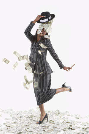 Businesswoman with money falling out of her hat Stock Photo - 16089346