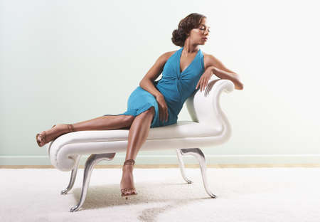 reclining chair: Young woman sitting on a reclining chair
