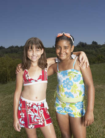 two persons only: Young girls smiling for the camera LANG_EVOIMAGES
