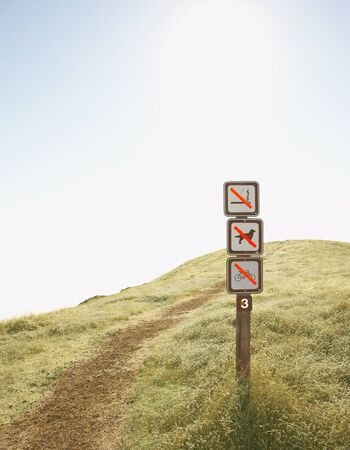 midsummer pole: Signs denoting forbidden actions by dirt path