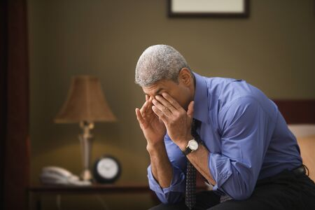motioning: Businessman rubbing his eyes