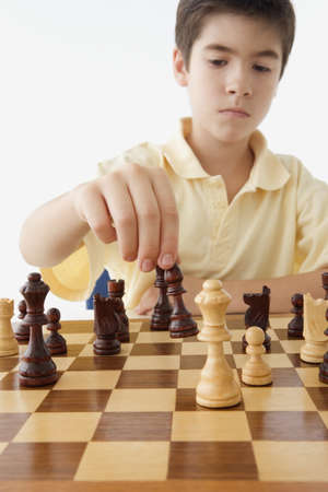 Young boy playing chess Stock Photo - 16089473