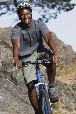 rugged terrain: Male cyclist in rugged terrain LANG_EVOIMAGES