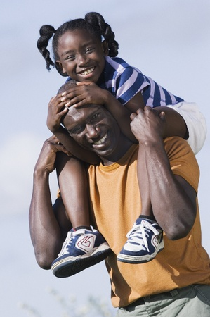 Father carrying his daughter on his shoulders Stock Photo - 16089496